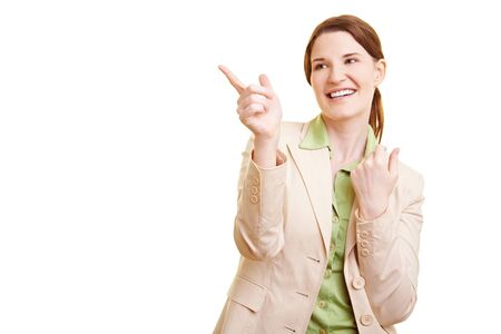 self discovery: Happy businesswoman pointing with her index finger to the left Stock Photo