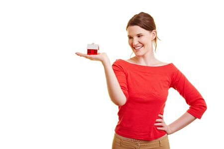 Happy woman holding a little red house in her hands Stock Photo - 7359779