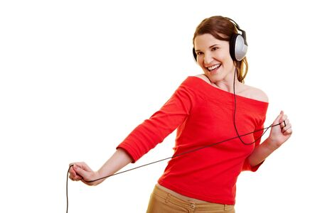 Young happy woman dancing with headphones on her head photo