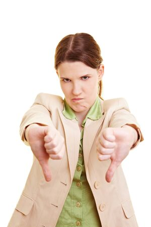 Unhappy young businesswoman holding her thumbs down photo