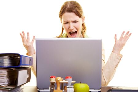 Stressed businesswoman shouting loudly at her laptop Stock Photo