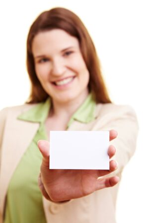 Smiling businesswoman holding an empty white business card photo