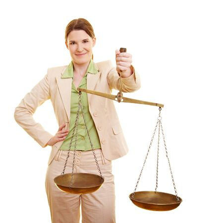 appraise: Female judge holding a beam balance in her hand