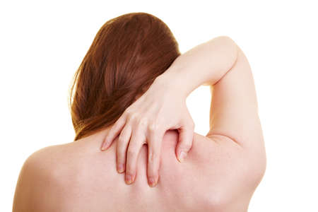 Woman from behing touching her aching back Stock Photo - 7360275