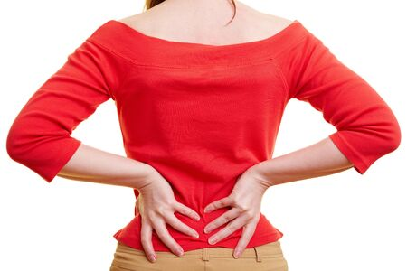 lean back: Woman holding her hands on her aching back