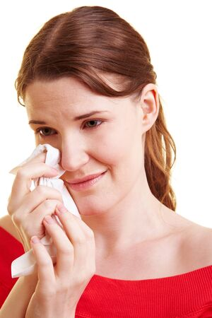 whining: Young sad woman with handkerchief drying her tears