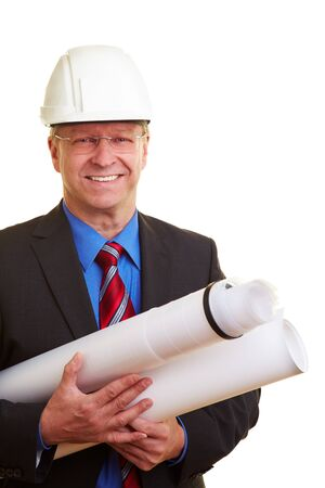 Architect with white helmet holding building plans Stock Photo - 7501495