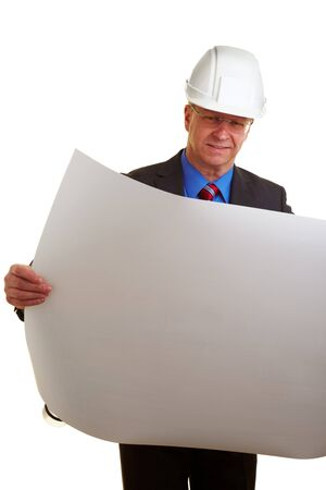 Architect with white helmet holding building plans Stock Photo - 7501475
