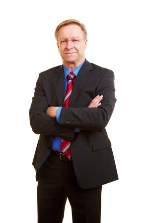 Portrait of a smiling senior businessman in a suit and tie photo