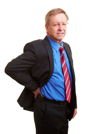 Elderly businessman holding his hand to his aching back Stock Photo - 7501487