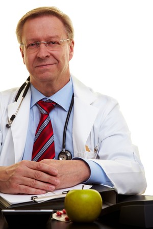 Seus senior doctor sitting in his office Stock Photo - 7518559