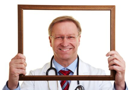 self conceit: Happy senior chief physician looking through an empty frame Stock Photo