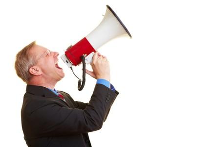 speaking tube: Senior businessman screaming loudly in a big megaphone