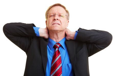 head pain: Senior businessman holding his hands to his aching neck Stock Photo