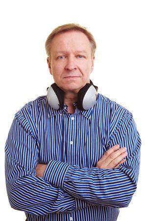 Elderly man with headphones around his neck photo