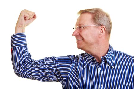 arm muscles: Elderly man flexing his upper arm muscles