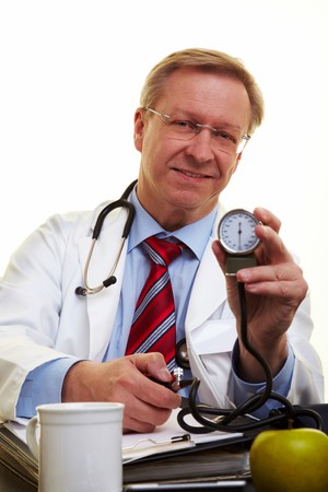 Elderly doctor showing a blood pressure meter Stock Photo - 7540408