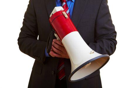 speaking tube: Senior businessman holding a big megaphone in his hand