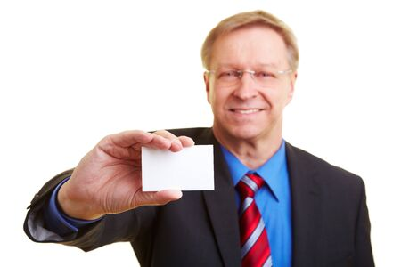 Senior businessman holding a white business card photo