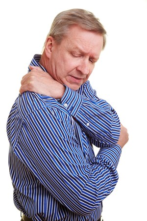 dorsalgia: Elderly man holding hands to his aching back Stock Photo