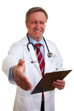 Happy senior chief doctor offering his handshake photo