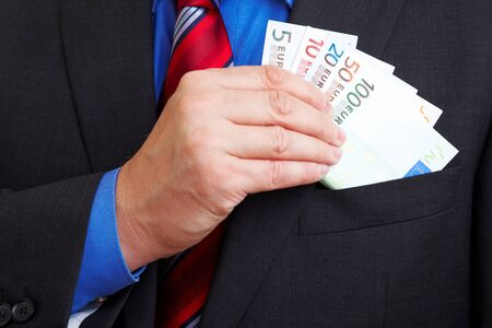 Senior businessman with many Euro banknotes in his pocket photo