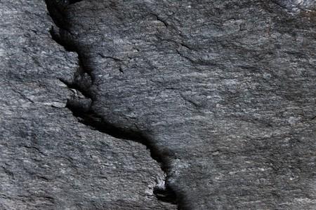 dark grey slate: Dark grey slate stone with a break