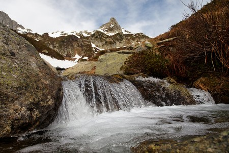 Small cascade on a mountain in the French Alps photo