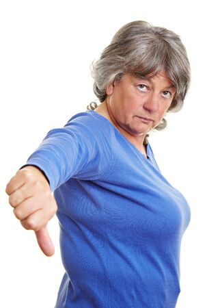 censure: Unhappy pensioner pointing down with her thumb Stock Photo