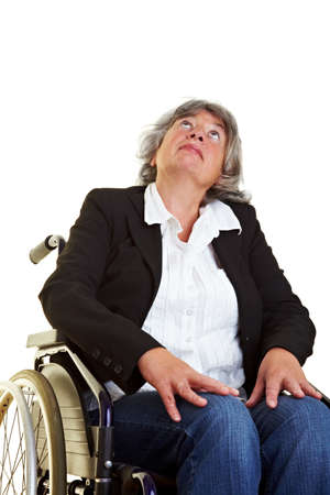 Elderly woman sitting in a wheelchair and looking up photo