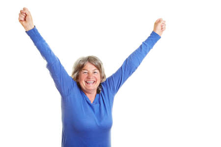 clench: Happy female senior citizen cheering with fists clenched