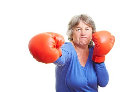 Elderly woman fighting with red boxing gloves photo