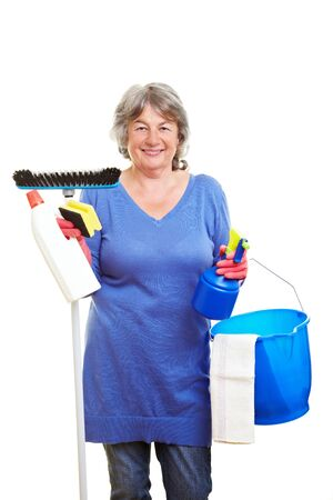 Happy retired woman holding many cleaning supplies Stock Photo - 7751446