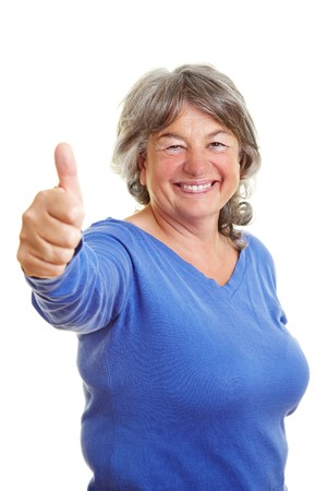 Happy elderly woman holding her thumb up Stock Photo - 7751934