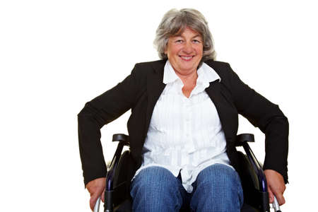 Smiling elderly disabled woman sitting in a wheelchair photo