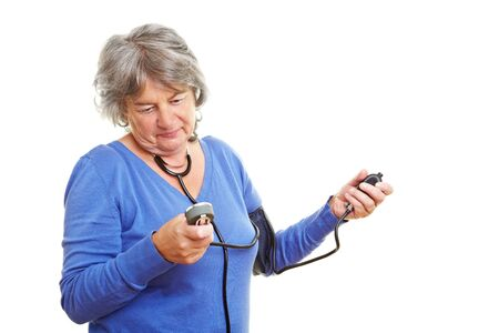 Elderly woman with gray hair measuring her blood pressure Stock Photo - 7751924