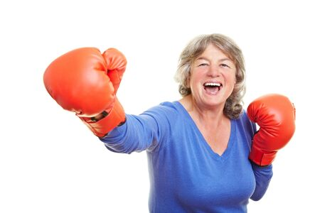 female boxer: Happy woman with boxing gloves smiling after a victory
