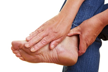 Wrinkled hands toching a naked aching foot Stock Photo - 7751922