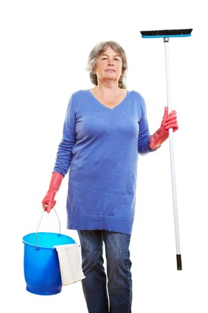 Happy retired woman holding many cleaning supplies Stock Photo - 7751547