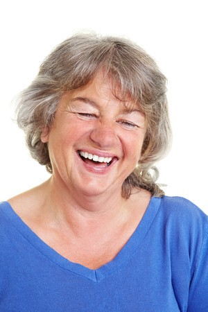 Laughing female senior citizen with gray hair photo