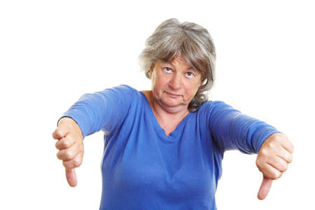 discontent: Senior woman pointing with her thumb down