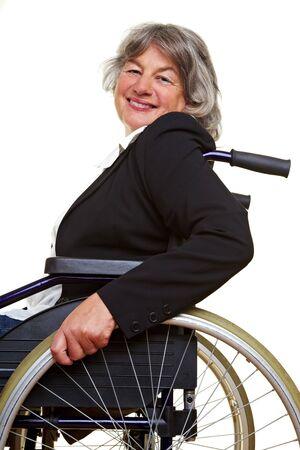 Elderly paraplegic woman sitting in a wheelchair photo