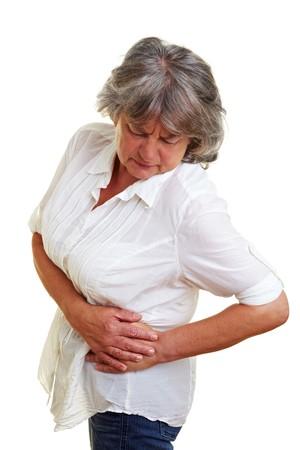 convulsion: Anciana con cabello gris tocar su cadera dolorido  Foto de archivo