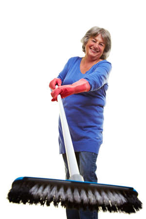 scrubber: Happy retired woman holding a scrubber into the camera