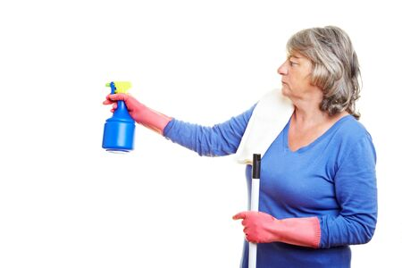Elderly cleaning lady using a spray bottle Stock Photo - 7752007