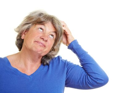 sceptical: A forgetful elderly woman scratching her head