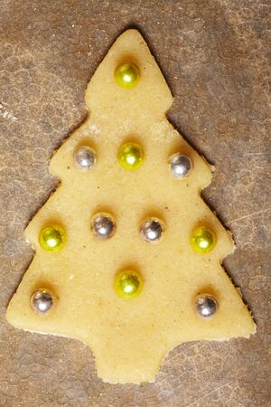 Decorated cookie with balls in shape of a christmas tree photo