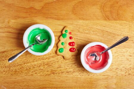 Bowls with food icing for decorating christmas cookies photo