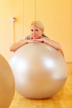 Happy woman in a gym with many gym balls Stock Photo - 7940559