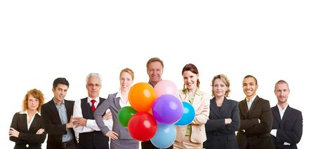 Group of business people celebrating with many balloons